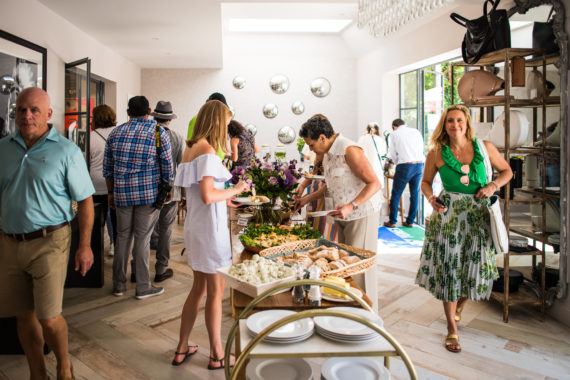 Guests dig into brunch at the Grand Slam Tennis Tours Hospitality House.